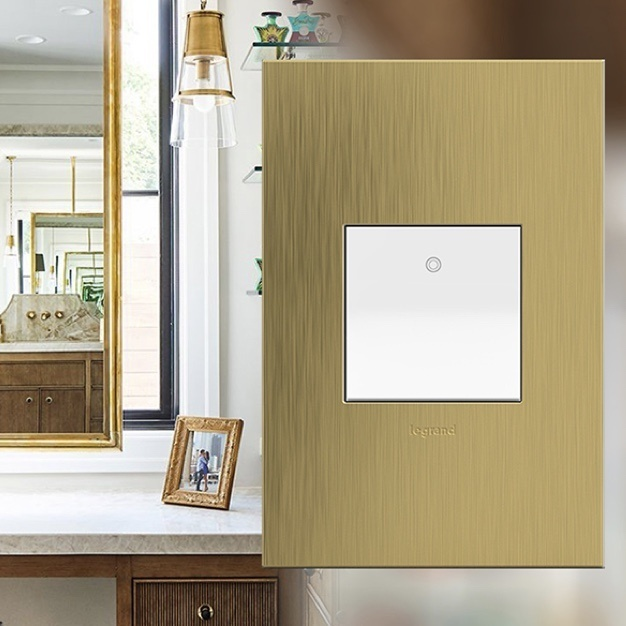 Whisper switch and Brushed Satin Brass designer wall plate from the adorne Collection by Legrand