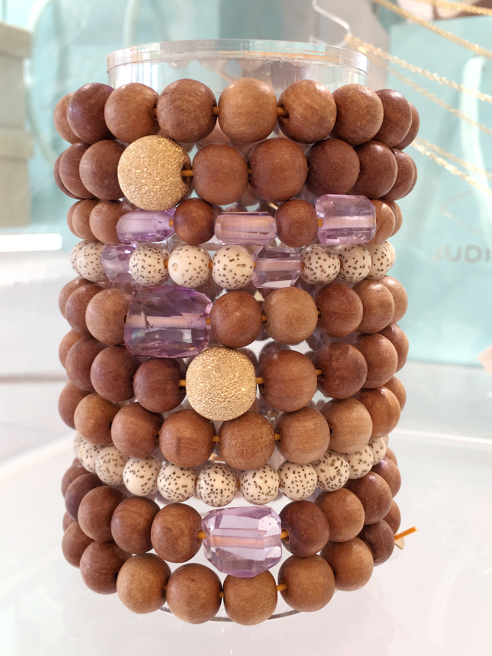 From Judith Bright: Sandalwood and pink amethyst bracelets, ranging from $48 to $108