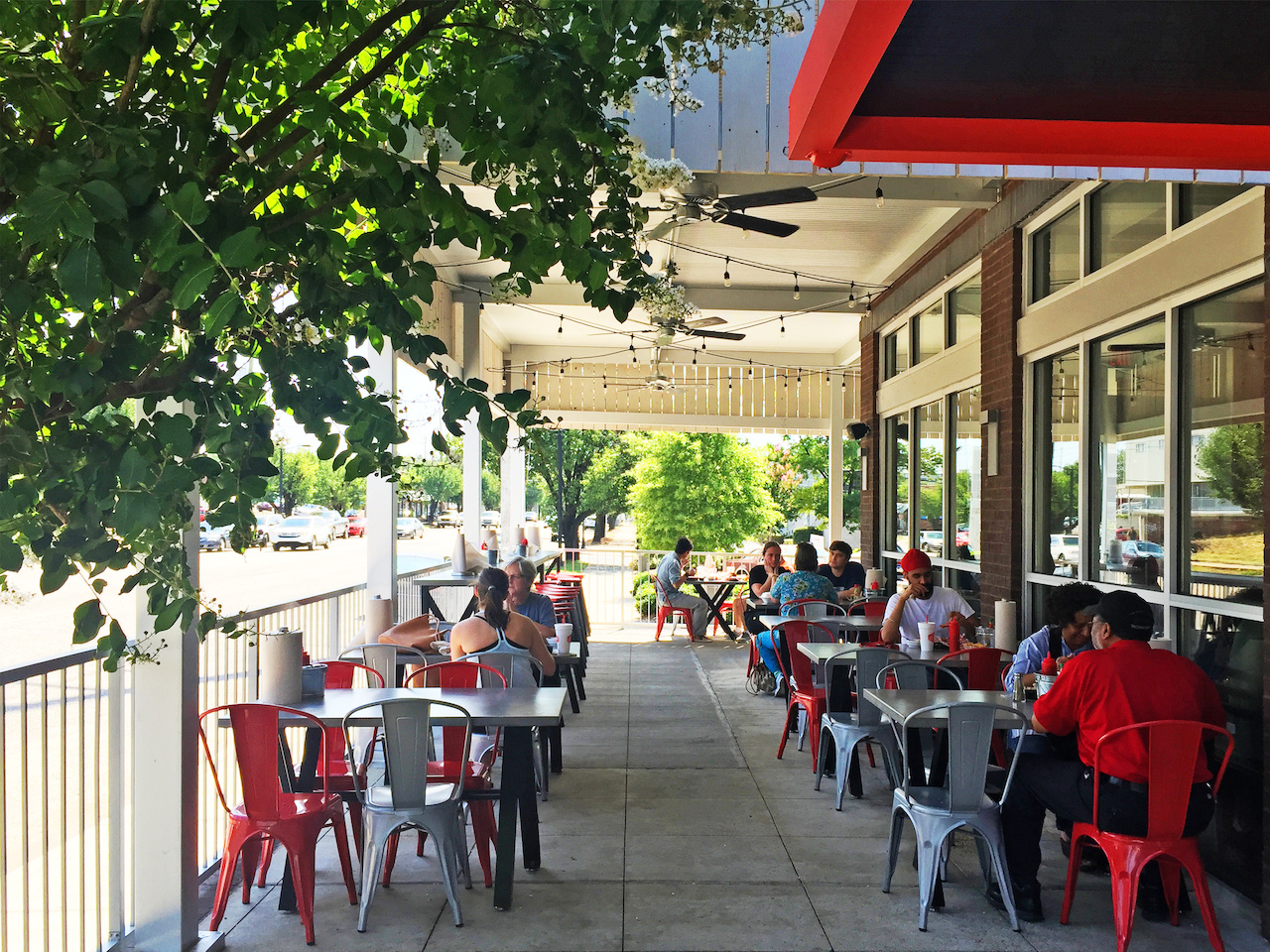 Hattie B's outside patio continues its comfortable and shared feeling.