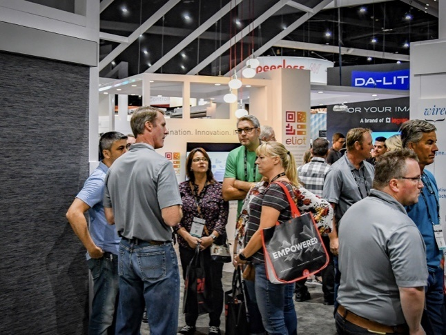 Authorized Qmotion Dealers gathered at a tradeshow