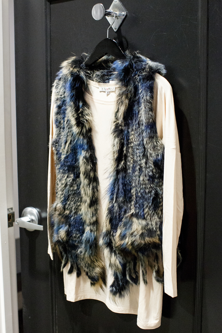 Fur vest by Dolce Cabo, $262 and Joy Joy pullover, $48 from Lori James