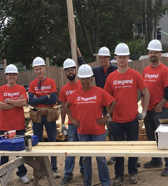 Legrand employees working on rebuilding a house for Habit for Humanity