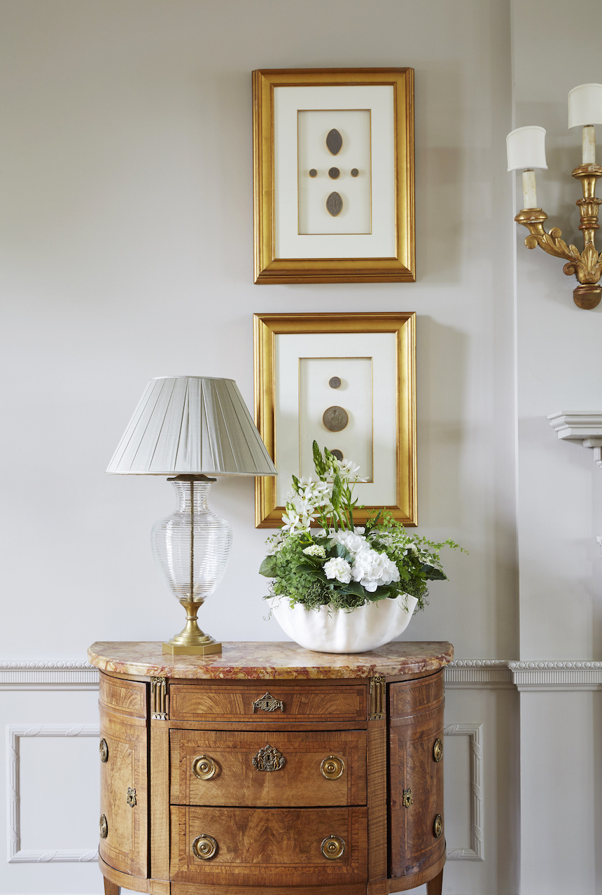 These antique intaglios are displayed in gilded frames. The clear etched crystal lamp was handmade in England and is topped with a beautiful silk chiffon shade in a warm taupe.