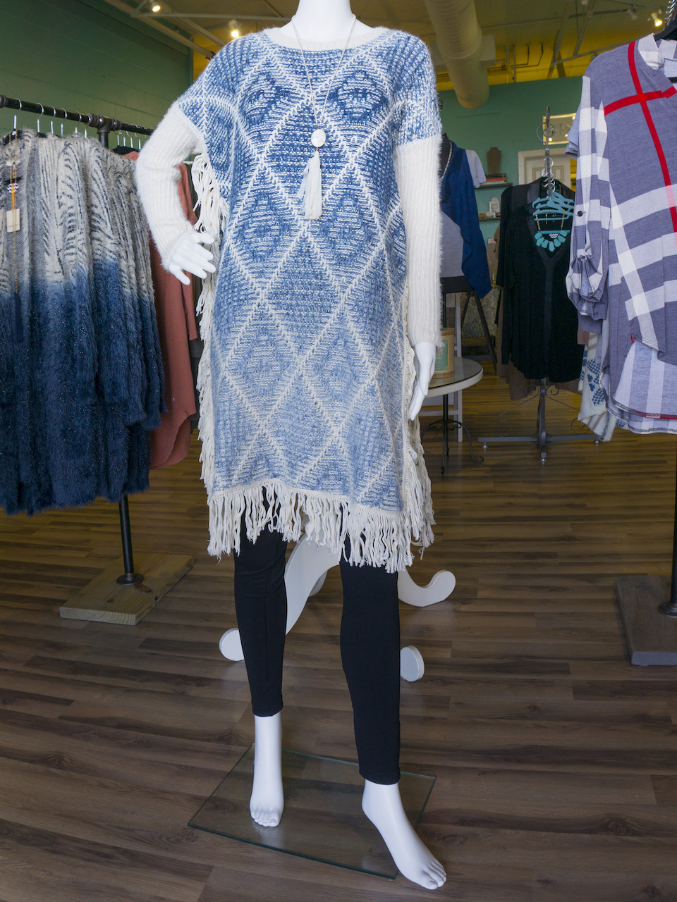 From Something Blue: Navy poncho with side split and fringe, $52; White tassle necklace, $28; Leggings, $15