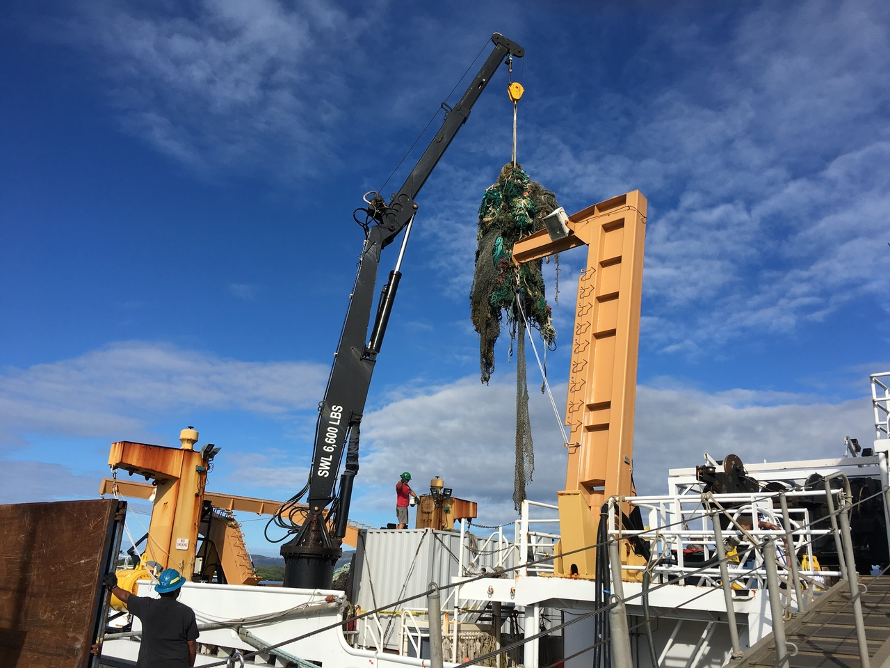 NOAA Ship Sette has safely returned to Pearl Harbor and offloaded the marine debris from the reef at Pearl and Hermes Atoll. Thanks to the ship's crew and help from other NOAA staff, the offload went smoothly. (Photo: NOAA Fisheries/Tomoko Acoba)