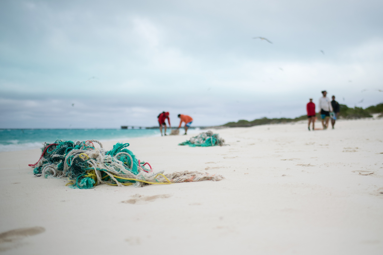 Marine debris team cleans up derelict fishing nets from the shores of Midway Atoll.