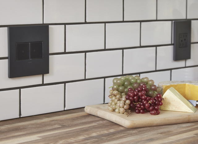 adorne switches and outlets on white tile in kitchen above countertops