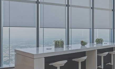 Commercial office working counter area with large shaded windows
