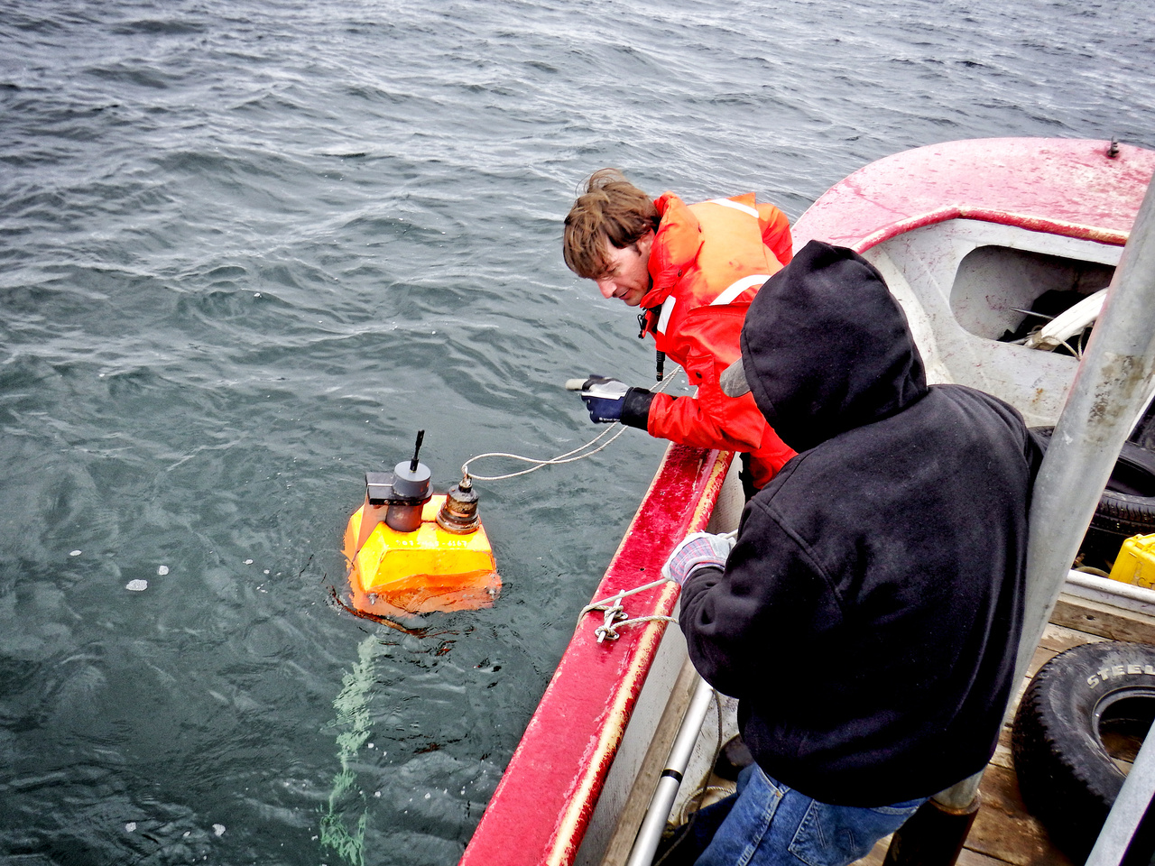 Beluga researcher Manuel Castellote deploying an acoustic recorder.