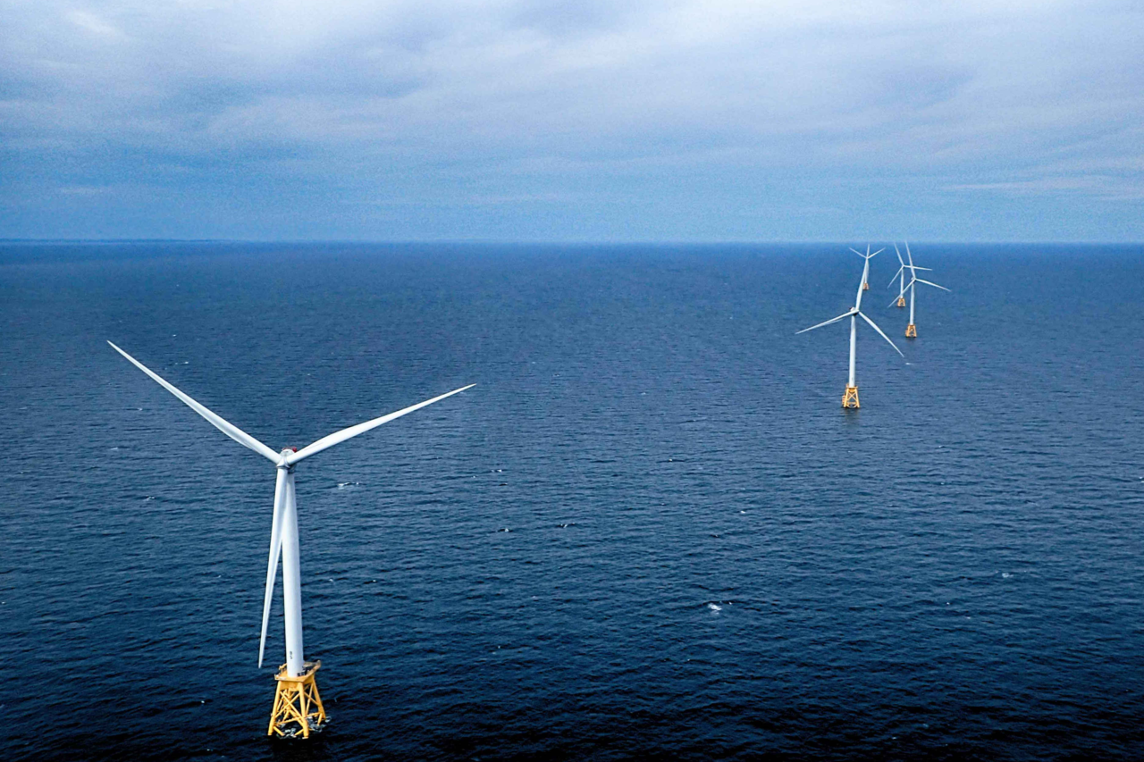 Three wind turbines in a line on the ocean waters of Block Island Sound
