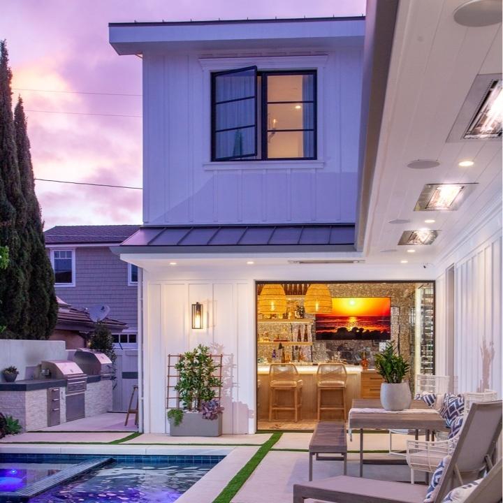 backyard pool with indoor-outdoor entertaining