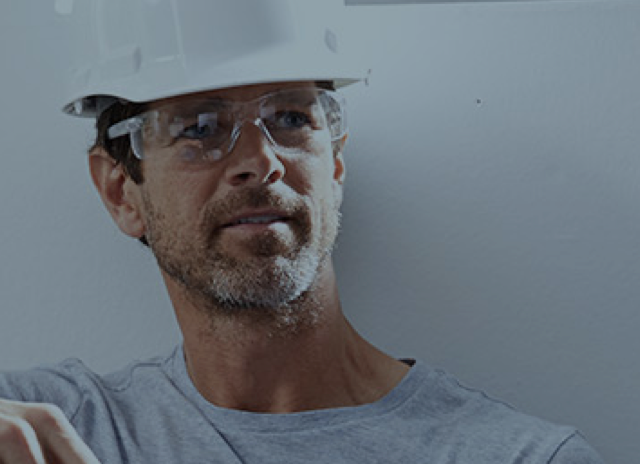 Worker with hard hat and safety goggles on