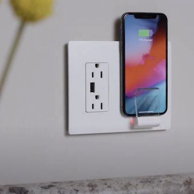 White In-wall wireless charging with phone in kitchen