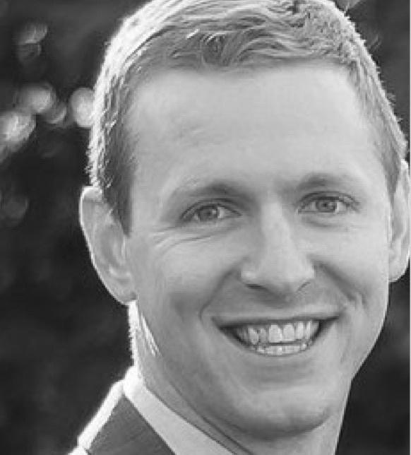 Close up headshot of man smiling