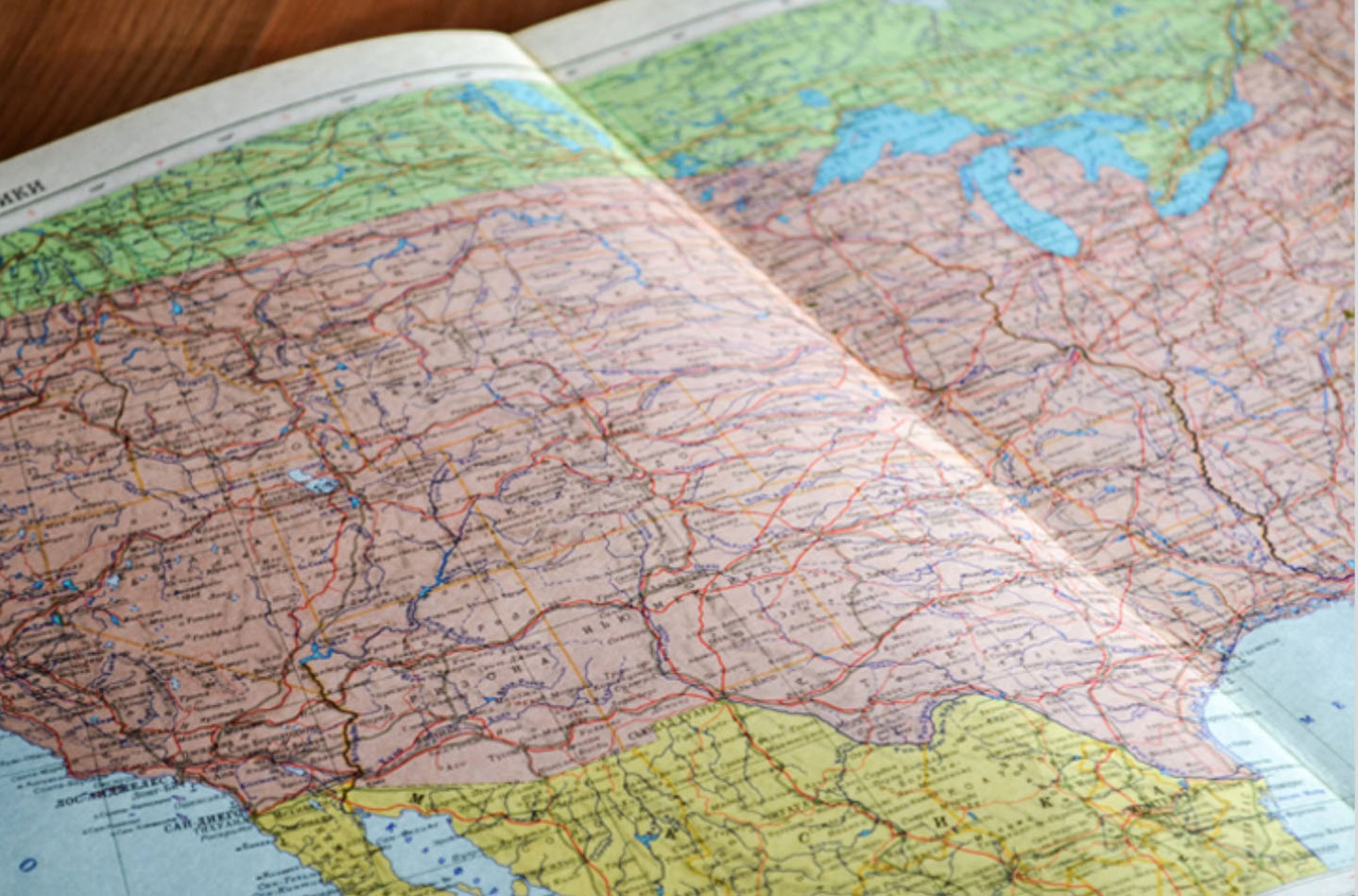 Map book open to a road map of the United States