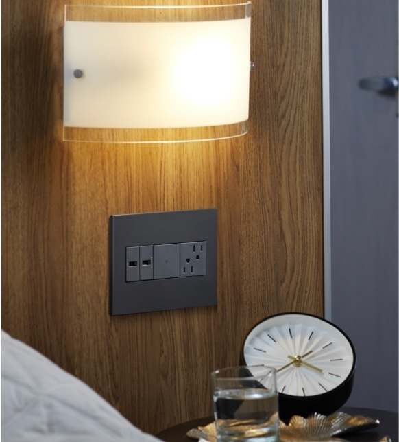 adorne furniture power center in wood panel over hotel nightstand