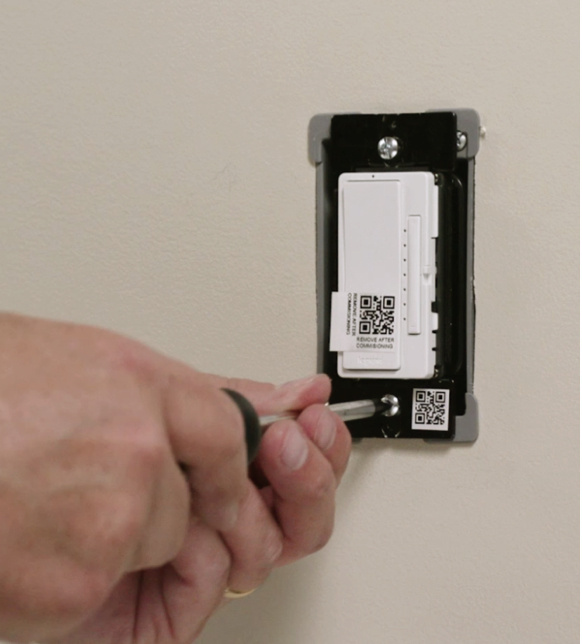 hand installing radiant dimmer