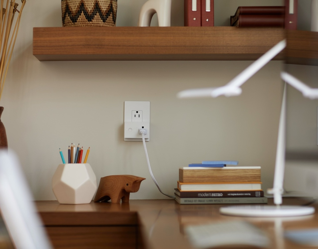 Image of desk with radiant outlet on wall