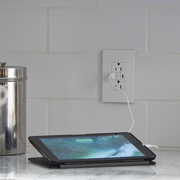 radiant Collection GFCI USB outlet charging a tablet