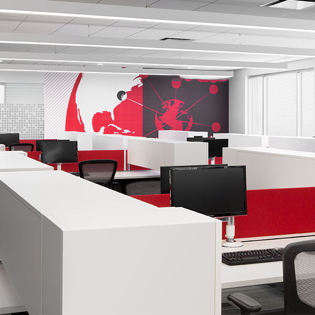Commercial office space with desks and contemporary mural on wall