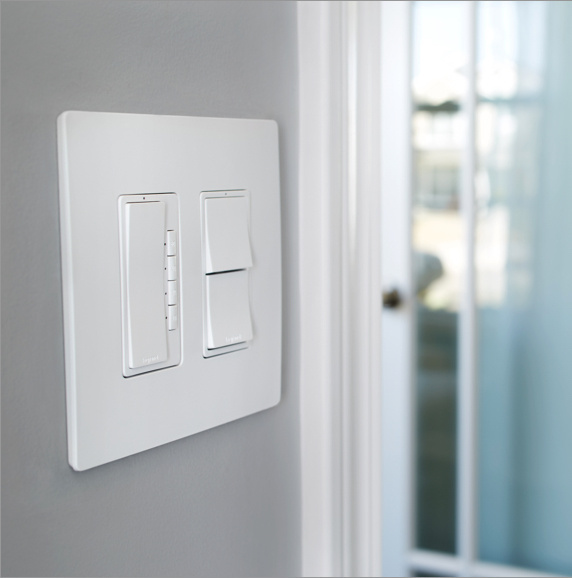 white radiant switches and dimmers against light gray wall in home