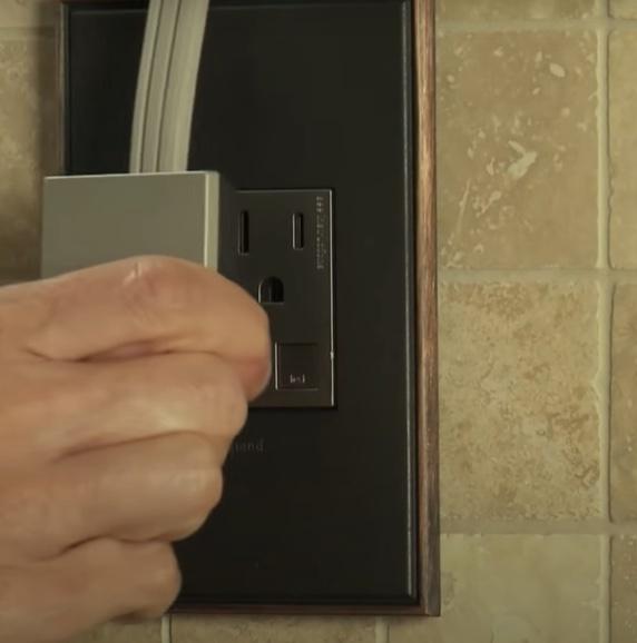 Plugging in adorne under cabinet lighting into adorne outlet