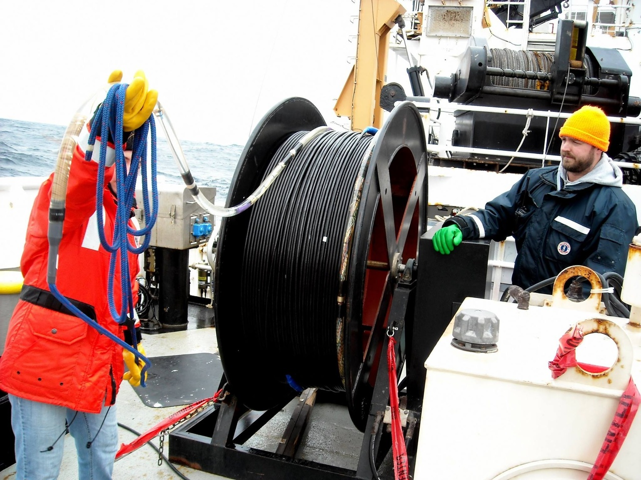 crew spooling hydrophone array on ship