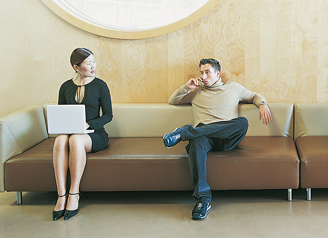 Woman and man on office building lobby looking at each other