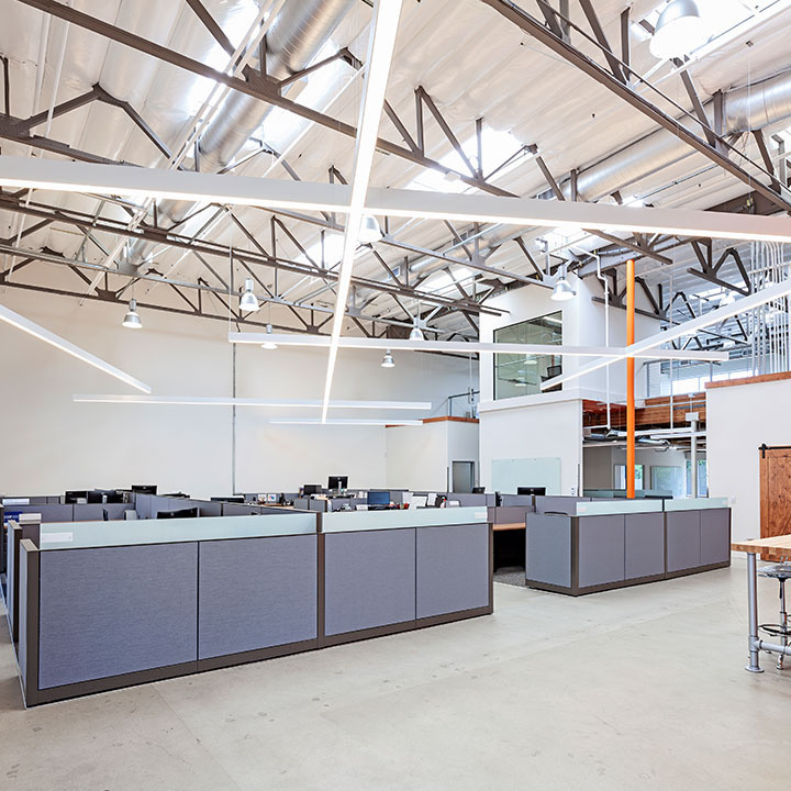 Large office space with contemporary overhead lighting