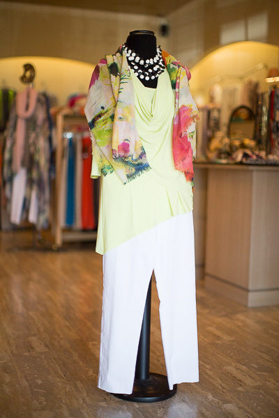 From Coming Attractions: 3/4 sleeve draped asymmetrical top in kiwi, $118; Crazy Larry pull-on pans $123;floral Tolani Challis scarf, $145 and multi-strand black and white necklace, $72
