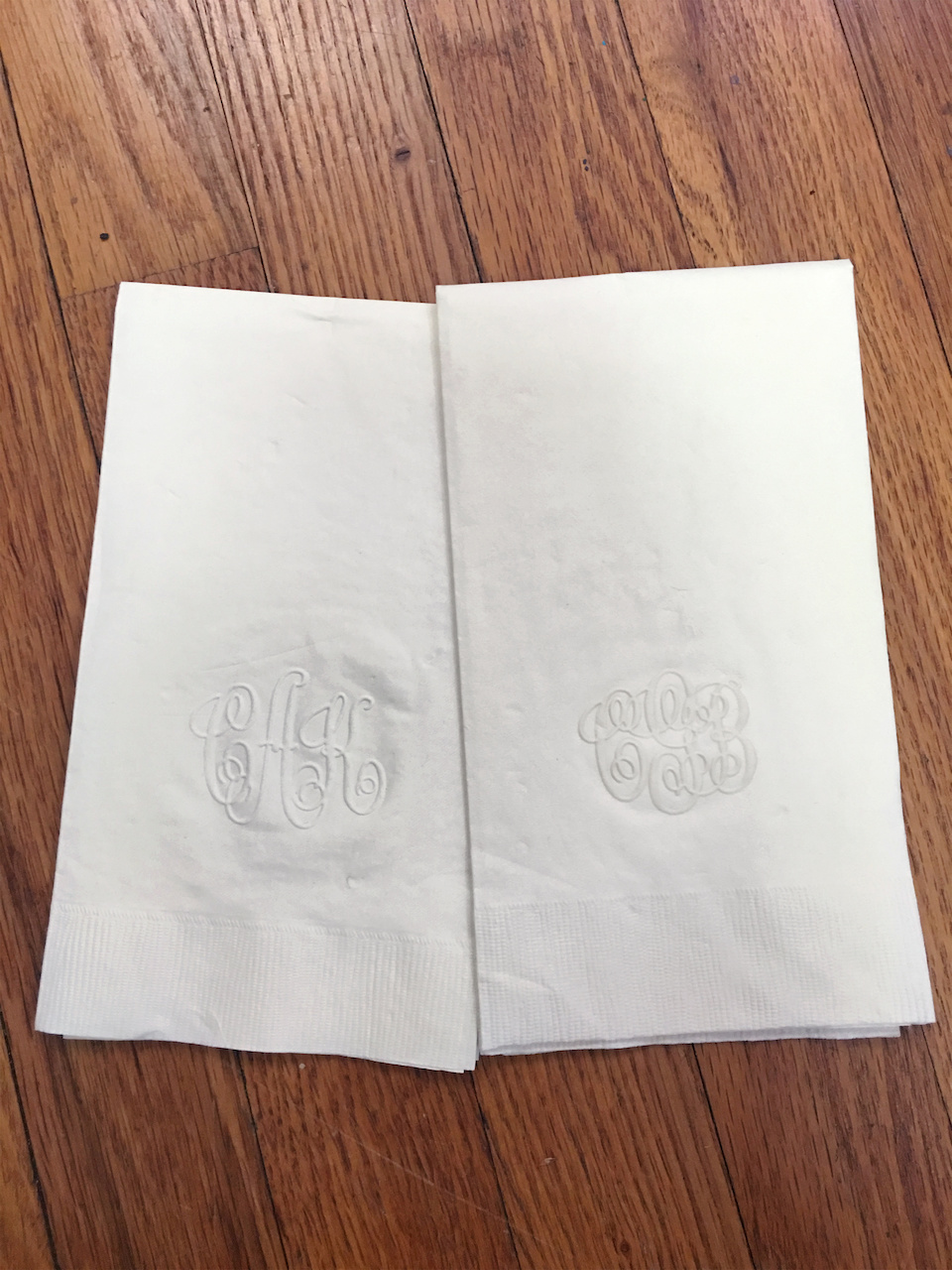 Monogrammed paper napkins, in bundles of 100 for $22.95 plus shipping, at The Scribbler