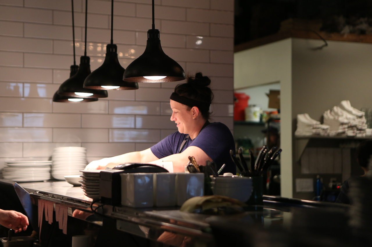 Chef Sarah Bradley, owner of Freight House, artfully directs her team through another busy Saturday night of creating beautiful, delicious dishes.