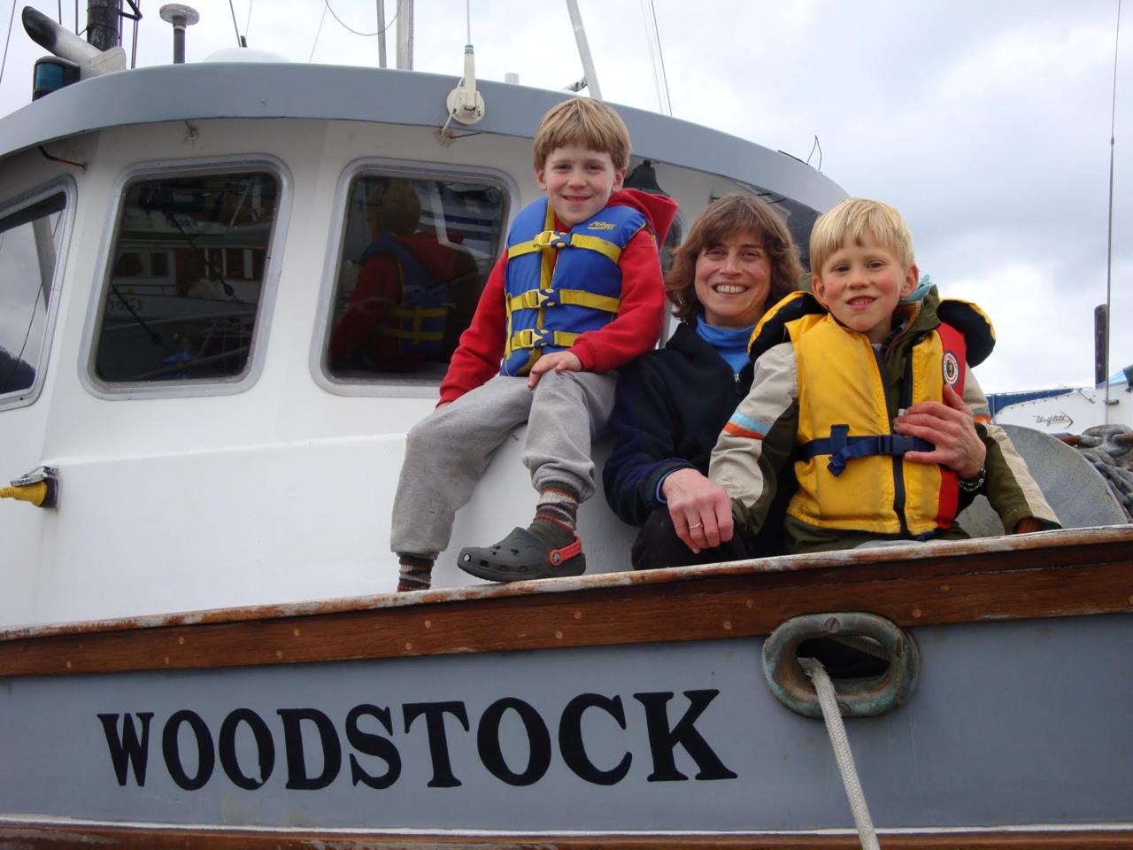 Linda Behnken and family on a boat in Alaska.
