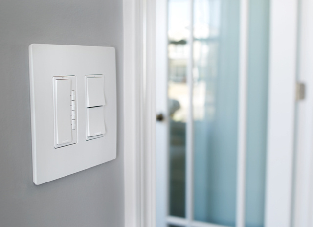 White radiant dimmer and switches against gray wall in home