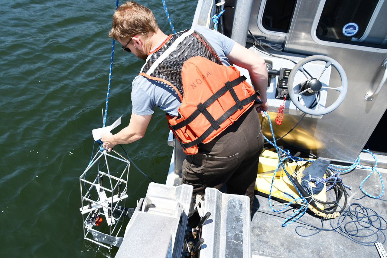 NCBO field technician deploys a video camera to research oysters.