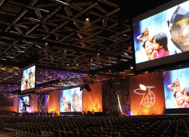 Mobile image of Projecta projector screens at a large conference