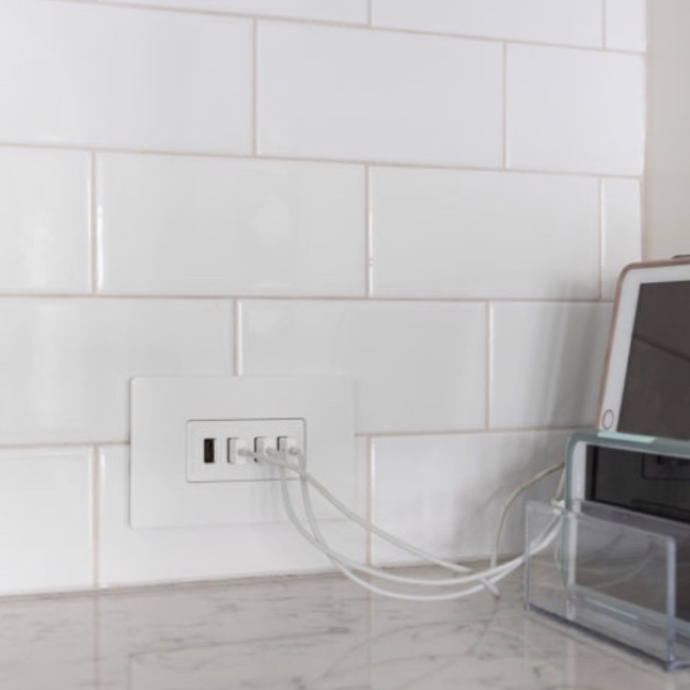 radiant Collection by Legrand Quad USB-A outlet on kitchen back splash charging three smart devices