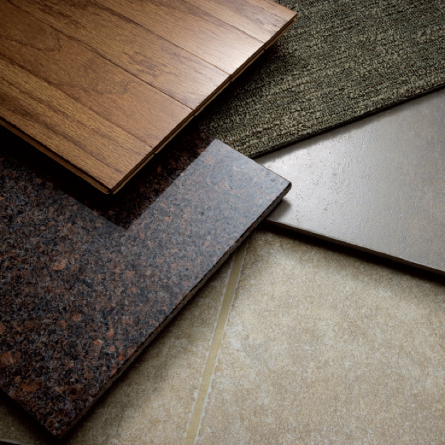 Stack of floor type swatches including wood, tile, and carpet