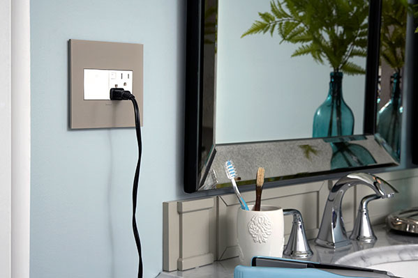 adorne outlet and wall plate in bathroom