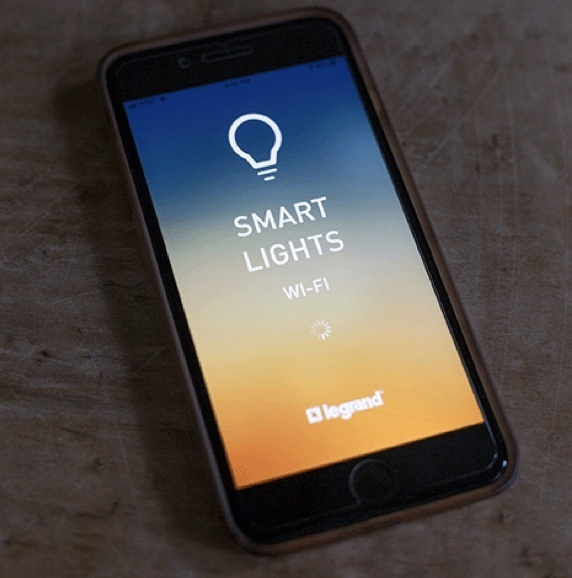 smart phone displaying Legrand Smart Lights app screen loading
