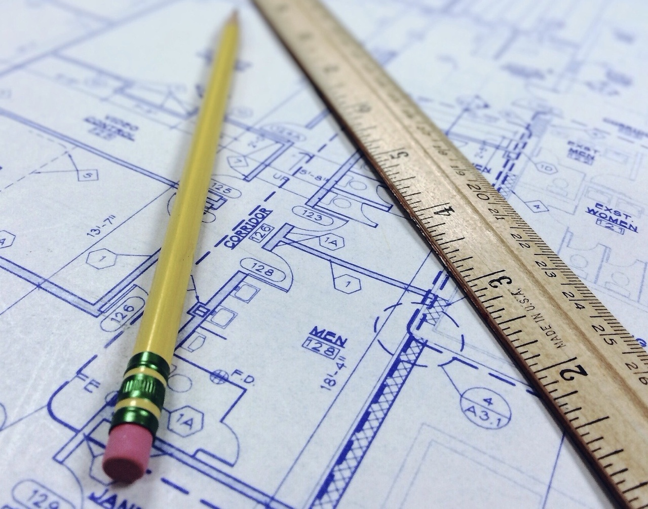 Blueprints with ruler and pencil