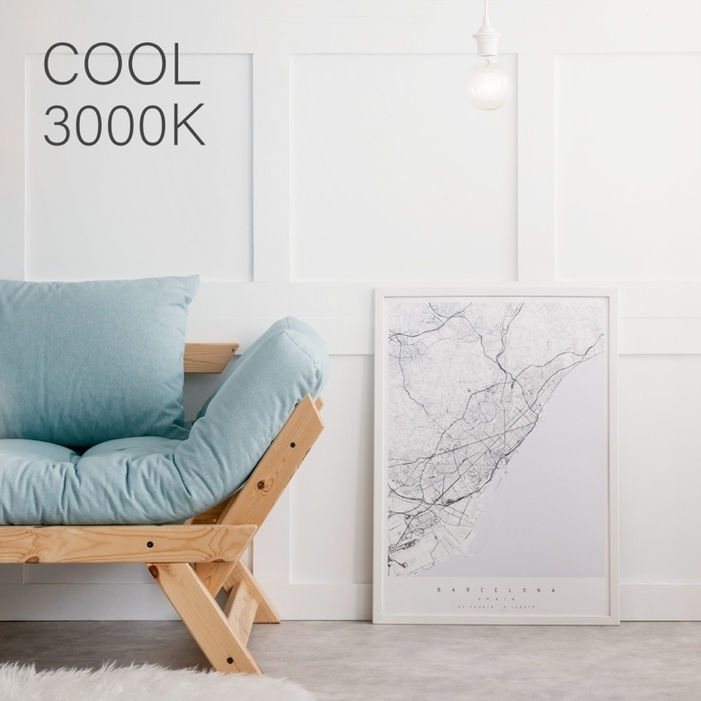 Wooden couch with blue cushions against a white wall and light gray overlay