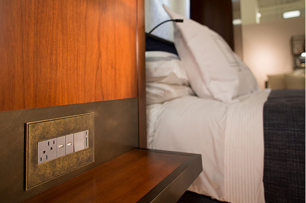 adorne outlets and switches in hotel bedroom