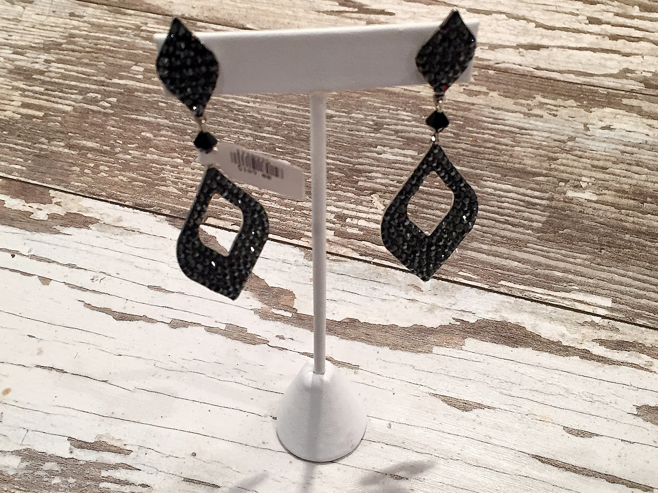 From The Clothes Tree: black diamond cutout earrings with pave crystals, $189