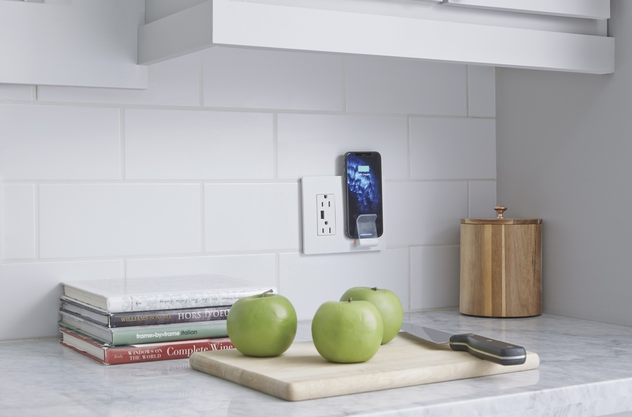 radiant Collection by Legrand wireless phone charger and outlet with smartphone charging in it