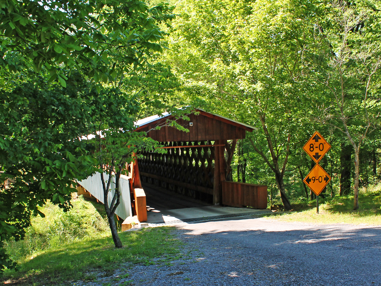 Old Easley Bridge is surrounded by lush greenery on Easley Bridge Road.