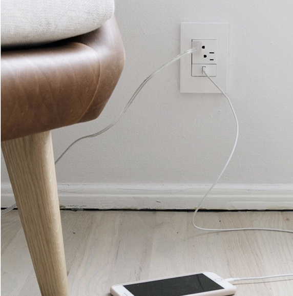 White USB outlet on white wall