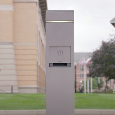 outdoor charging station pole with light by building
