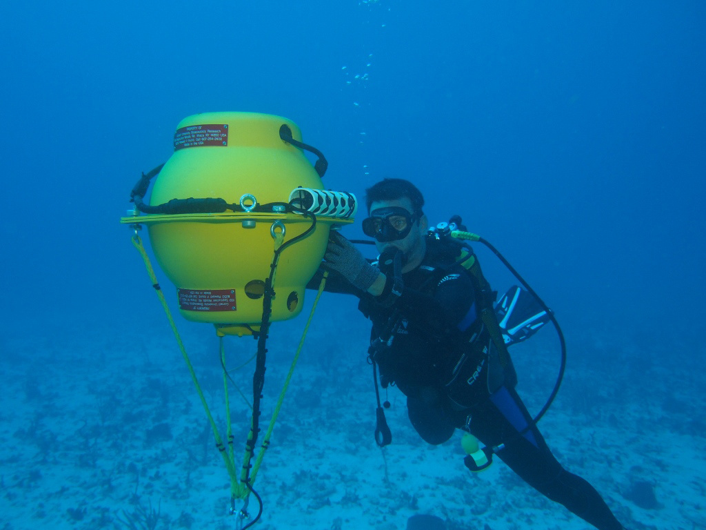 diver checking underwater recording device