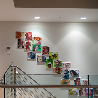 Staircase with painted portraits lining the wall